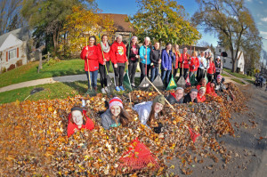 """Twenty-five members of the """"Falls Angels"""" teamed up to clean a yard in the 16500 block of Mary Court."""
