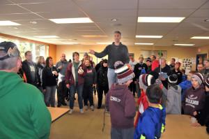 """Matt Goihl, chair of the """"Leaf Raking for Seniors Citizens"""" event, gives students, parents, coaches, and Optimist Club Members final instructions before sending the team out for a morning of raking. The folks that worked enjoyed donuts and juice at the Recreation Center."""