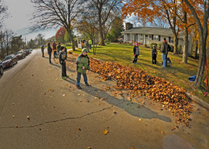 With the sun low in the morning sky, it cast a long shadow of Gavin Pawlowski, age 8, a third grader at Riverside School. Gavin with other members of Cub Pack 109 cleaned a yard in the 8700 block of Shepherd Drive.