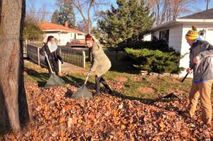 MFHS Junior Optimist Club members Melanie Upscomb and Grace Hurst, both sophomores and freshman Max Kachelek (l-r) raked in a yard along Menomonee Avenue.